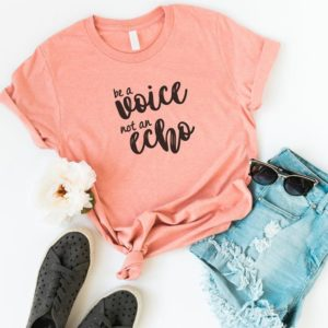 Be a voice funny shirts for women shirt with quotes graphic Peach / black print